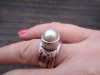 silver, copper and pearl ring